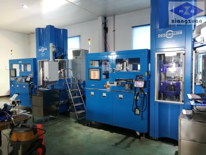 Osterwalder pressing machine for CNC inserts